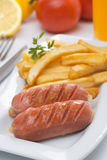 Grilled sausage with french fries Stock Image