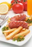 Grilled sausage with french fries Stock Photos