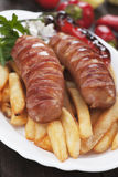 Grilled sausage and french fries Royalty Free Stock Photo