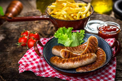 Grilled sausage with french fries Royalty Free Stock Photo