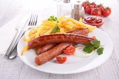 Grilled sausage and fries Royalty Free Stock Photography