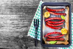 Grilled sausage with garlic and bay leaves, top view Stock Photography