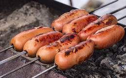 Grilled sausage on the grill Stock Photography