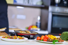 Grilled sausage with grilled vegetables on kitchen table Royalty Free Stock Photo