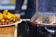 Grilled sausage with grilled vegetables on kitchen table Stock Images