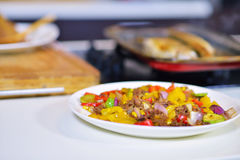 Grilled sausage with grilled vegetables on kitchen table Royalty Free Stock Images