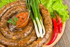 Grilled sausage (kielbasa) closeup Royalty Free Stock Images
