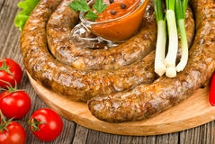Grilled sausage (kielbasa) closeup Stock Images