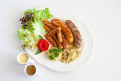 Grilled Sausage with Mash Potato and Sauerkraut.  Royalty Free Stock Photography