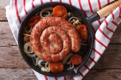 Grilled sausage in a pan. horizontal top view close-up Royalty Free Stock Photos