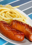 Grilled sausage with pasta stock photos