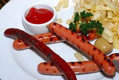 Grilled sausage with potato Royalty Free Stock Images