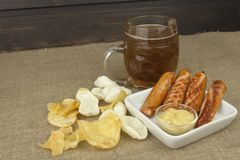 Grilled Sausage and potato chips. Stock Photos