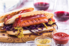 Grilled sausage sandwich with sweet coleslaw and tangy mustard Stock Photos