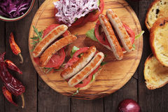 Grilled sausage sandwich Stock Images