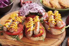 Grilled sausage sandwich Royalty Free Stock Images