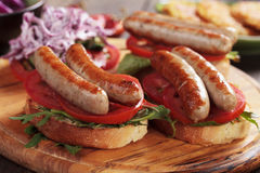 Grilled sausage sandwich Royalty Free Stock Photos