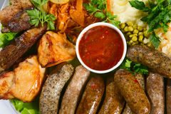 Grilled sausage with sauce Royalty Free Stock Images