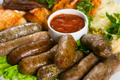 Grilled sausage with sauce Royalty Free Stock Photography