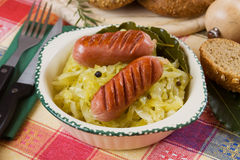 Grilled sausage with sauerkraut Royalty Free Stock Photos