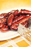 Grilled sausage served on a plate Stock Image
