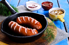 Grilled sausage Stock Images