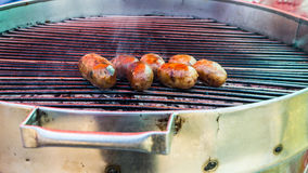 Grilled sausage with some smoke Royalty Free Stock Image