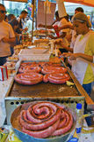 Grilled sausage at street market stand Stock Images