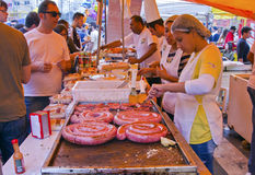 Grilled sausage at street market stand Royalty Free Stock Images