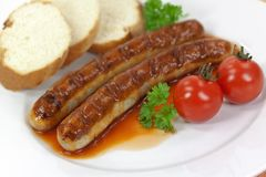 Grilled sausage with tomato ketchup Stock Image