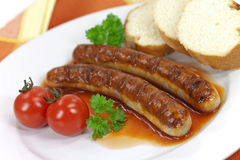 Grilled sausage with tomato ketchup Royalty Free Stock Images