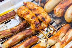 Grilled sausage and turkey. Stock Image