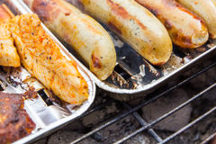Grilled sausage and turkey. Stock Photography