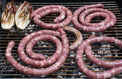 Grilled sausage, typical food of the trips. Stock Photos