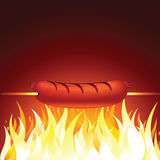 Grilled Sausage Vector. Meat Wurst on Hot Flame Background. Vector Royalty Free Stock Images