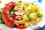 Grilled sausage,vegetable salad and potato Royalty Free Stock Photography
