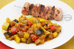 Grilled sausage with vegetables Royalty Free Stock Photos