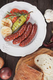 Grilled sausage and vegetables Stock Image