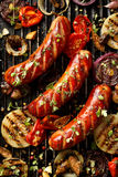 Grilled sausage and vegetables, top view royalty free stock photo