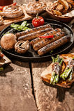 Grilled Sausage and Vegetables on Wooden Table Royalty Free Stock Photo