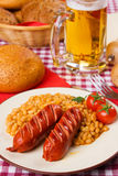 Grilled sausage with white beans Royalty Free Stock Photos