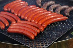 Grilled sausages. Symbol of free time Royalty Free Stock Image
