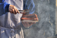 Grilled sausages. A chef serving grilled sausages on the street royalty free stock photos