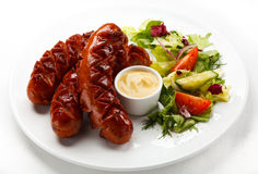 Grilled sausages. Group of grilled sausages and mustard stock photo