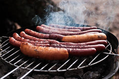 Grilled sausages. Different sizes with smoke stock photos