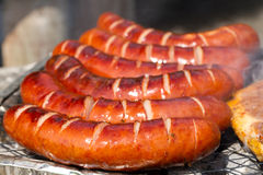 Grilled sausages on the barbecue Stock Photos