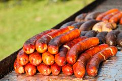 Grilled sausages on barbecue Royalty Free Stock Photos
