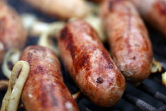 Grilled sausages, barbecue. Grilled sausages close-up, barbecue Royalty Free Stock Image