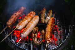 Grilled sausages. On barbecue ready to eat Royalty Free Stock Photography