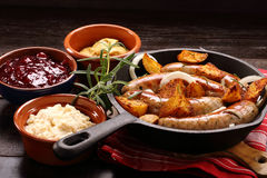Grilled sausages with barbecue sauce baked in a frying pan Royalty Free Stock Images